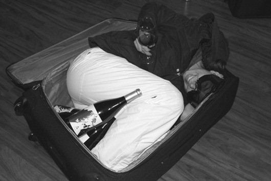 Flying with wine? Make sure the wine fits in your bag, then pack your wife!